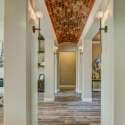 Hallway with brick ceilings