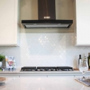 White ceramic backsplash with KitchenAid appliance