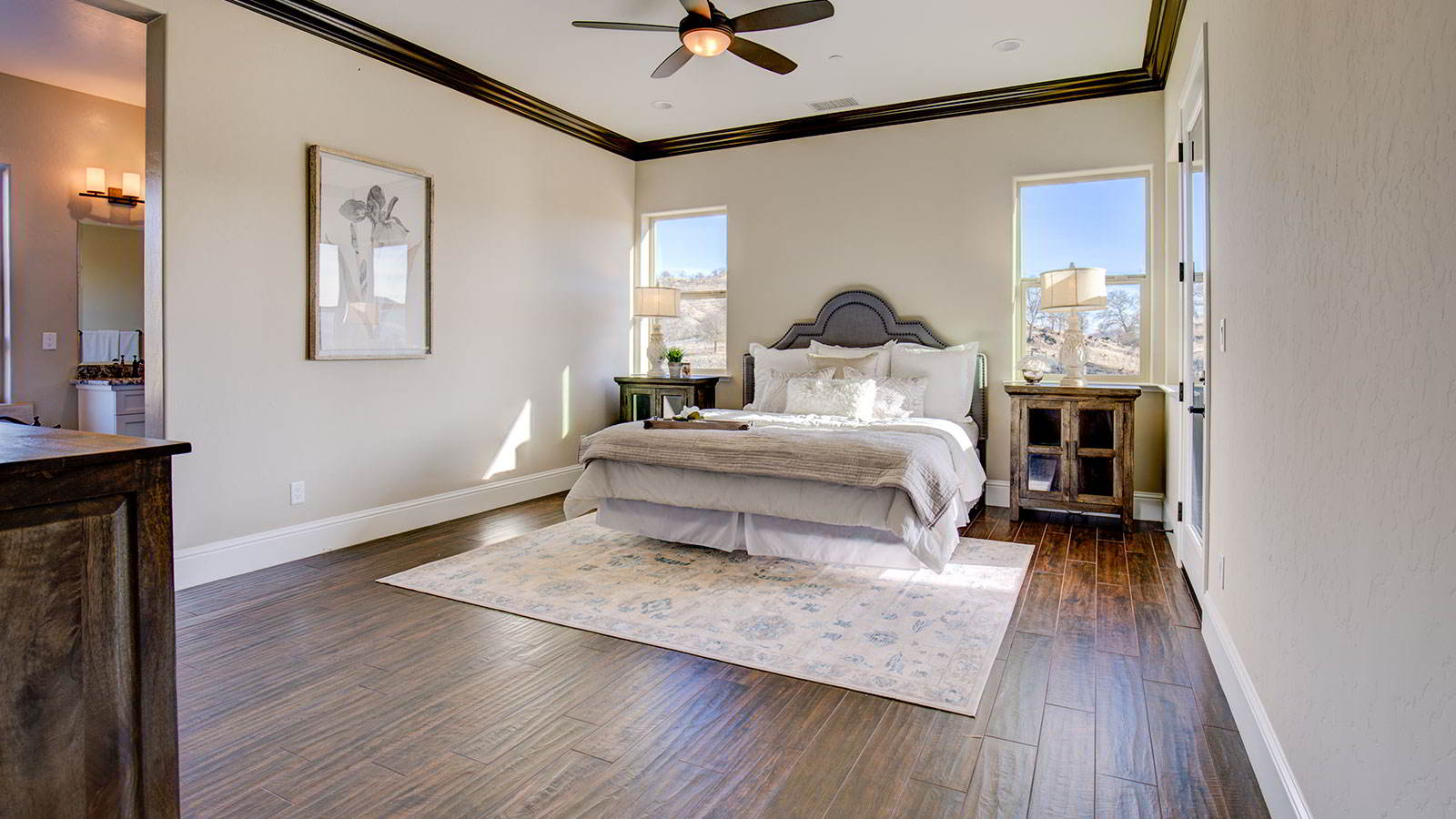 The rustic farmhouse inspired nightstands in this Estates line owner's suite offer plenty of storage and style.