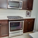 A gas stove and over-stove microwave in the kitchen.