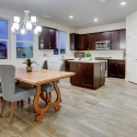 A view of the open plan dining nook and kitchen.