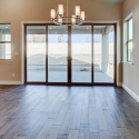 Large glass doors leading to the back patio from the dining nook in the great room.