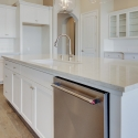 Another view of the kitchen island, with built-in sink and dishwasher.