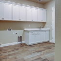 The spacious laundry room, with custom cabinetry.