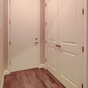 The mudroom leading to the garage, with double-door closet to the right.