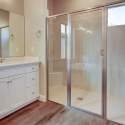 The large tiled walk-in shower in the owner bathroom, with built-in sitting ledge.