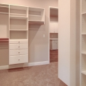 Custom shelving and cabinetry in the owner closet., which connects to the laundry room.