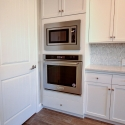 Built-in stove and microwave.