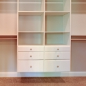Custom shelving an drawers in the owner's closet.