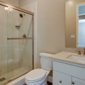 Step in shower and toilet in bathroom 3.
