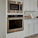 Built-in KitchenAid stove and microwave.