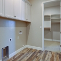 Laundry room with door leading to the master closet.