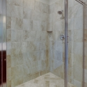The tile step-in shower in the owner's bath.