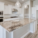 Oversized kitchen island with stunning granite countertop.