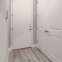 Mudroom with large coat closet.