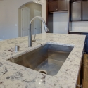 The kitchen sink, located at the kitchen island.