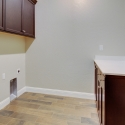 The laundry room, featuring upper and lower cabinets.