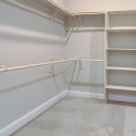 The spacious walk-in owner's closet, with custom shelving.