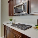 Built-in Whirlpool 5-burner gas cook top and above-range microwave.