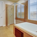 Tiled-in tub and walk-in shower in the owner's bathroom.