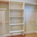 Shelving and hanging rods in the owner's walk-in closet.
