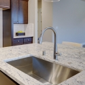 The sink, located at the kitchen island.