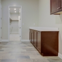 The laundry room, with upper and lower cabinets.