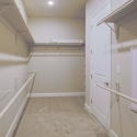 The walk-through owner's closet, which connects to the laundry room.