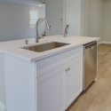 The kitchen island, with sink and dishwasher.