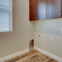 The laundry room, with overhead cabinets.