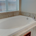 The tiled-in bathtub at the owner's bath.