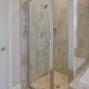 The tile-wall shower at the owner's bath.