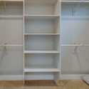 Custom shelving and hanging rods in the owner's walk-in closet.