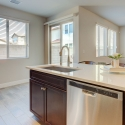 The kitchen island, with sink and built-in dishwasher.