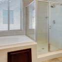 The bathtub and step-in shower in the owner's bath.