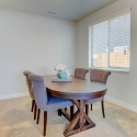 The den/bonus room, shown staged as a dining room.