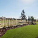 Backyard with wrought iron fence against the golf course.