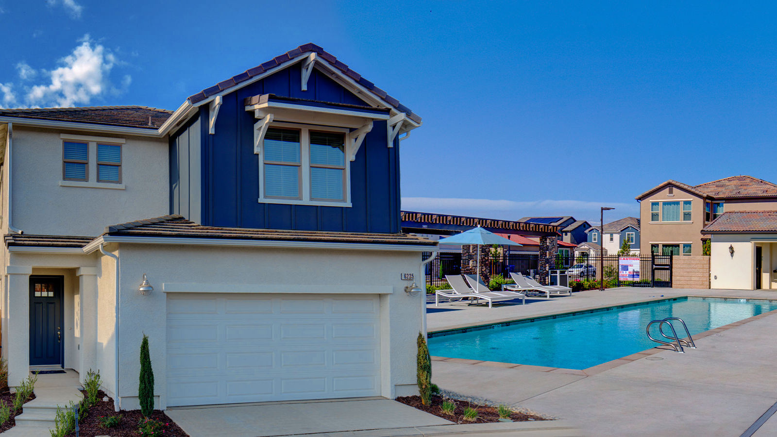 Composite image of the pool at the Gated Canvas Collection at Belterra and the exterior of a modern farmhouse Canvas 1.