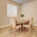 The study or bonus room, shown staged as a dining area.