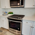 Whirlpool oven and above-range microwave.