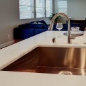 The sink located at the kitchen island.