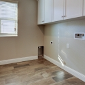 The laundry room, with upper cabinets.