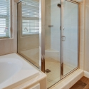 Step-in shower and tiled-in bathtub in the owner's bathroom.