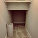 Storage space and hanging rod under the stairs.