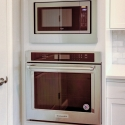 The built-in Whirlpool oven and microwave in the kitchen.