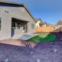 Additional view of the landscaped backyard.