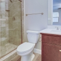 The private bath in the fourth bedroom, with tile step-in shower.