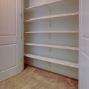 The linen closet located in the upstairs hallway.