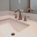Close-up of the sink and faucets in the powder bath.