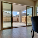 The large sliding glass door located at the dining nook, which leads to the covered patio.